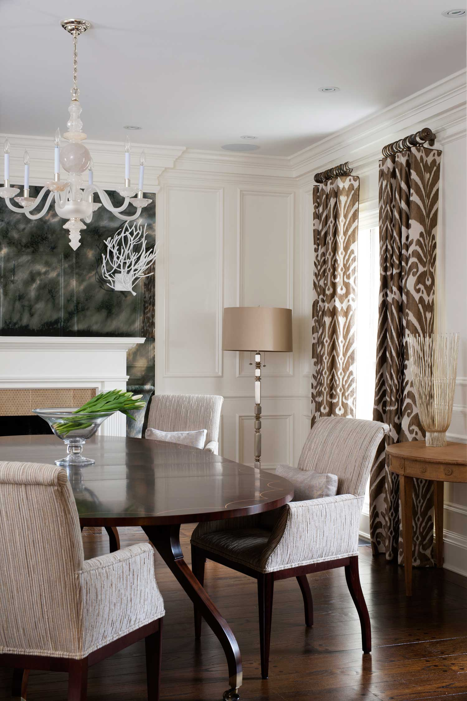 Classic modern dining room fireplace jim thompson ikat fabric drapes modern light fixture interior design Bethesda MD Ella Scott Design